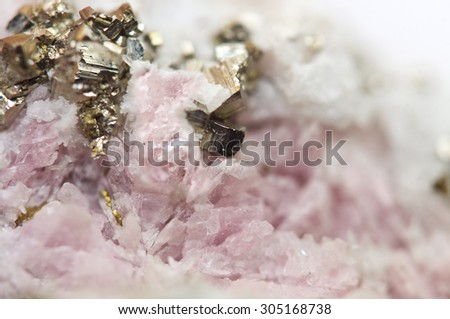 Rhodochrosite is a manganese carbonate mineral with chemical composition MnCO3 with iron pyrite FeS2 Macro - stock photo