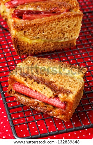 Rhubarb and custard cakes on a red background