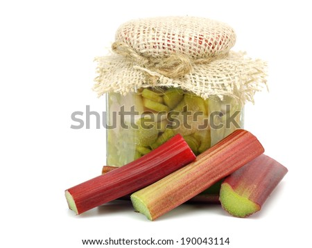 Rhubarb jam in glass jar on white background        - stock photo