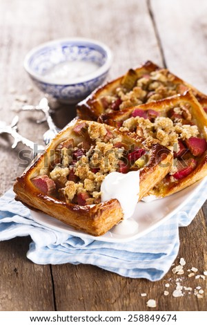 Rhubarb pies with oatmeal streusel - stock photo