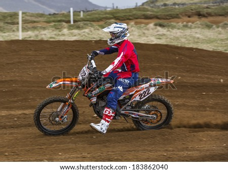 RHYNIE, ABERDEENSHIRE, SCOTLAND - 23 MARCH: This is a Motocross Rider at practise on an open to the public MX Track situated at Rhynie, Aberdeenshire, Scotland on 23 March 2014.