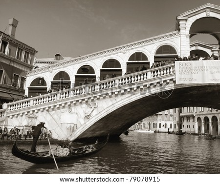 Rialto bridge with gondola, Venice, Italy