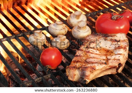 Rib Steak, Tomato and  Mushrooms Roasted Over Flaming BBQ Grill - stock photo