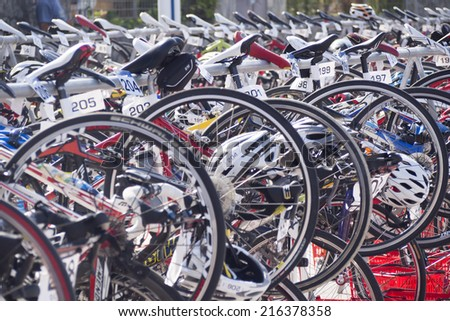 RIBADESELLA. SPAIN - SEPTEMBER 6, 2014: bicycles compound in the place of transition, during the triathlon festival in Ribadesella at the Olympic distance while triathletes were swimming - stock photo