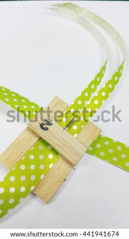 Ribbon break into two equal parts  - stock photo