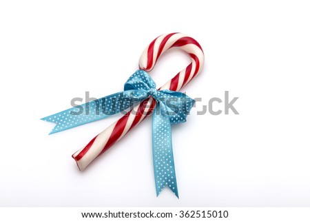 ribbon candy canes on a white background - stock photo