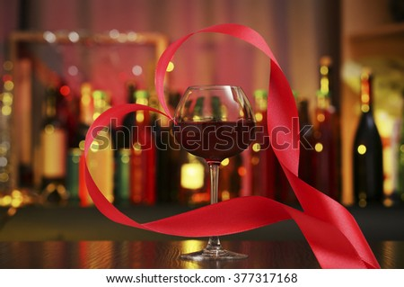 Ribbon shaped as heart on city night background