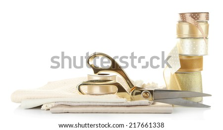 Ribbon with scissors and fabrics isolated on white - stock photo