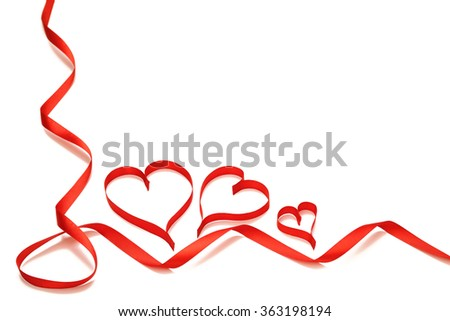 Ribbons shaped as hearts on white background.  Valentines day concept.