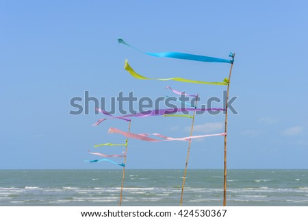 Ribbons tied bamboo in the wind and blue sky background or backdrop