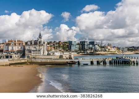 Ribeira beach and boat finger pier with Lisbon Riviera on the background in Cascais, Portugal.