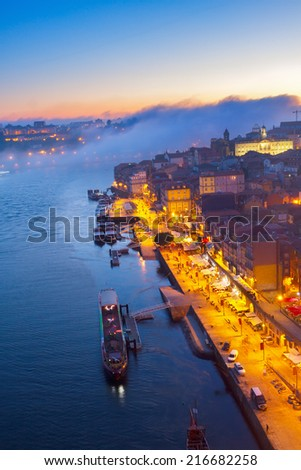 Ribera embankment in  old town of Porto at blue night, Portugal - stock photo