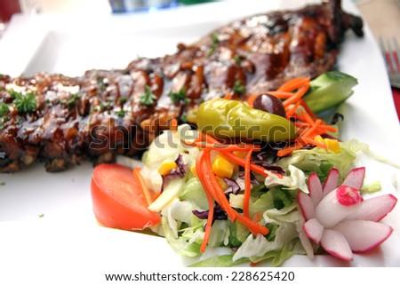 Ribs and salad Amsterdam - stock photo