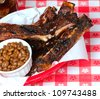 Ribs in a basket with beans and cola - stock photo