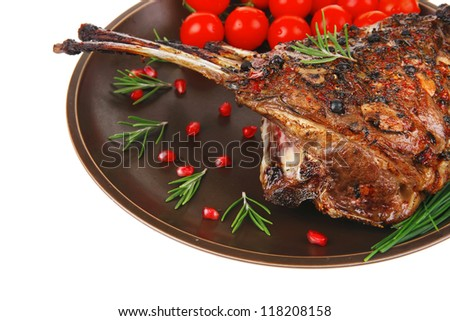 ribs portion on plate with cherry and chives - stock photo
