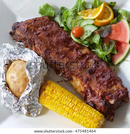 ribs with roasted corn and potato