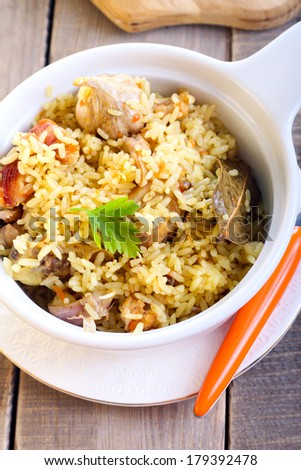 Rice and chicken casserole on table