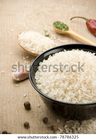 rice and healthy food on wood - stock photo