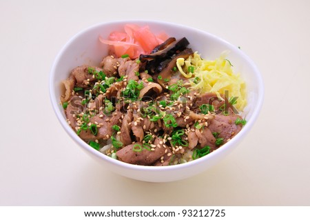 Rice and meat in white bowl