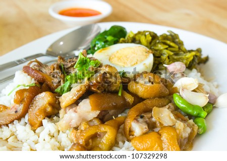 Rice and pig leg - stock photo