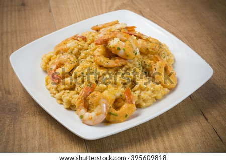 Rice and praws over wood - stock photo