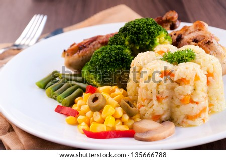 Rice and vegetables on plate. Selective focus on the rice and corn