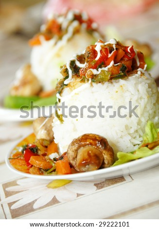 rice and vegetables served on plate for dinner - stock photo
