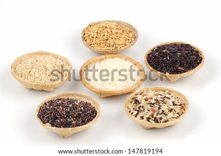 Rice berries, jasmine rice, brown nose, pile of unmilled rice grains, rice, and five species on the white background. - stock photo