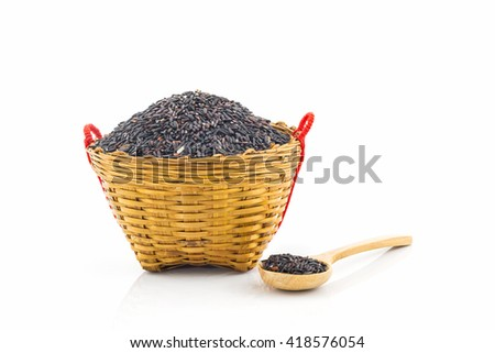 Rice berry in a wooden spoon and basket on white background. - stock photo