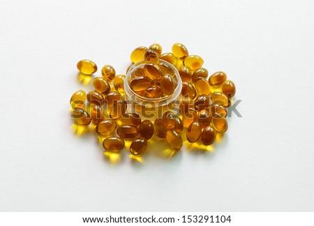 Rice bran oil pills on white background, Supplementary food - stock photo
