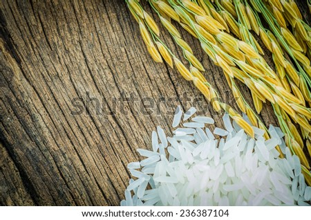 rice, brown rice, white rice on wood background vintage vintage - stock photo