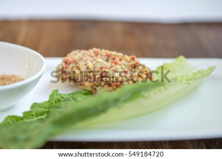 Rice cakes with Romaine lettuce in the background-.