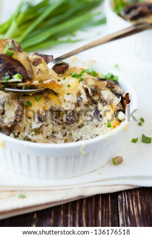 rice casserole with mushrooms and cheese, food closeup