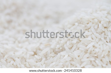 Rice close-up shot for use as background image or as texture - stock photo