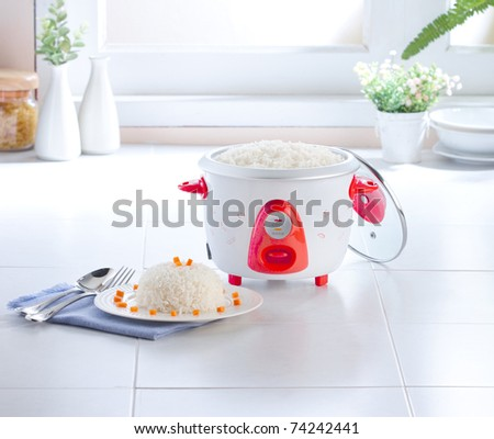 Rice cooking pot isolated in the kitchen interior  - stock photo