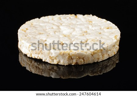 Rice cracker isolated on the black background with reflection - stock photo