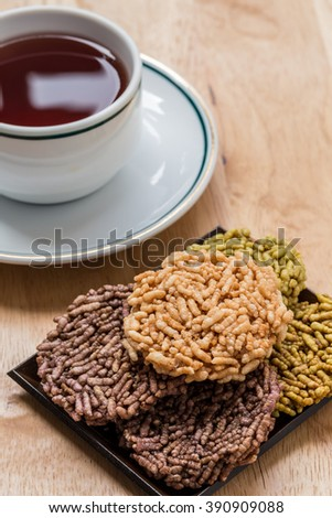 Rice cracker or rice biscuits with A cup of hot tea - stock photo