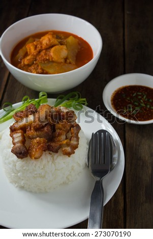 Rice crispy pork and Sour soup with papaya and fish - stock photo