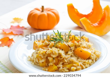 Rice dish with pumpkin, risotto on the plate - stock photo