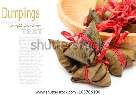 Rice dumplings on basket on white background - stock photo