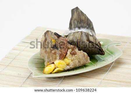Rice dumplings or  zongzi with tea - stock photo