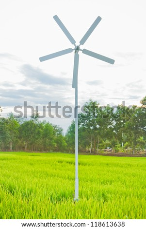 Rice field with wind turbines in thailand - stock photo
