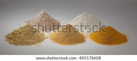 rice flour , sorghum and three different types of flour corn on a white background