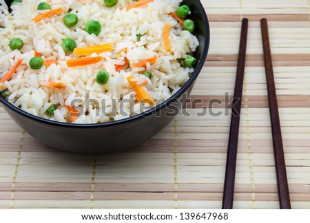 rice fried with vegetables in a bowl