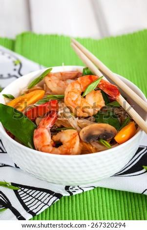 Rice glass (cellophane) noodles with shrimps and vegetables in white bowl  - stock photo