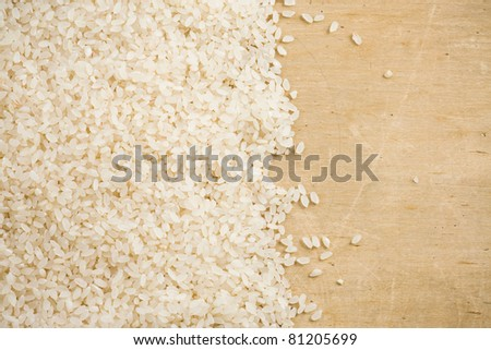 rice grain and wooden background - stock photo