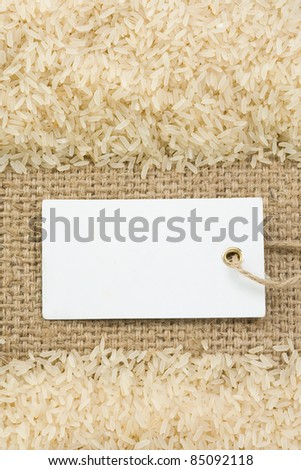 rice grain at sack burlap background  texture - stock photo