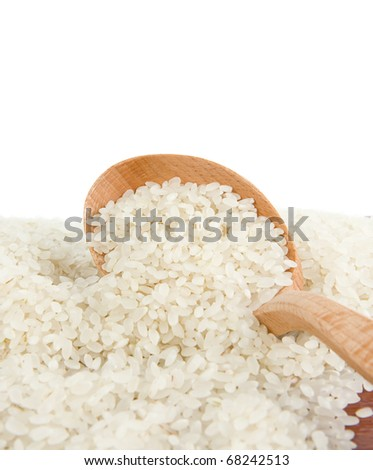 rice grain in wooden spoon isolated on white background