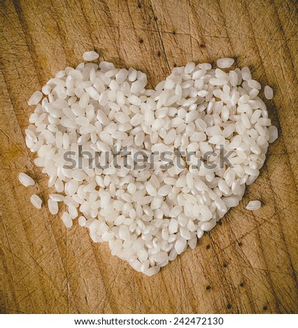 Rice heart on wooden background in a overhead shot - stock photo
