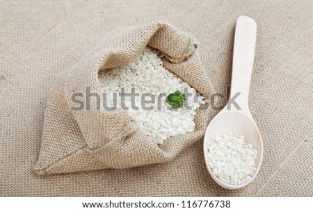 Rice in a bag on sacking. - stock photo